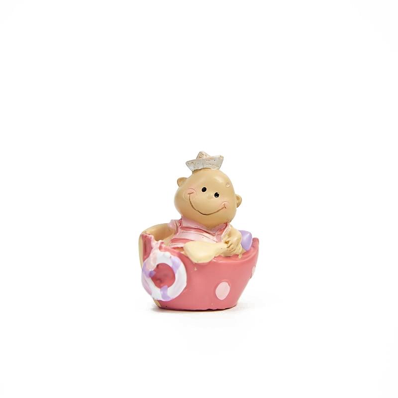 Bebe roz in barca/baie